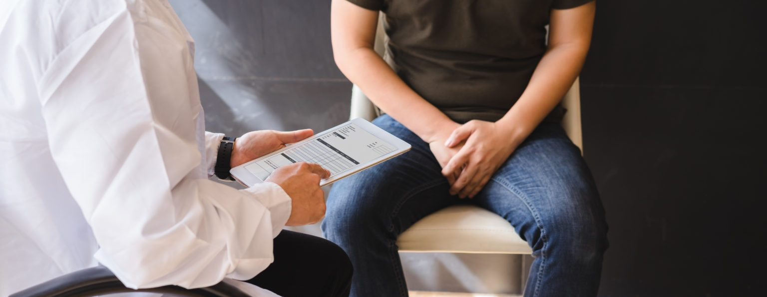 Male doctor and testicular cancer patient are discussing about testicular cancer test report. Testicular cancer and prostate cancer concept.