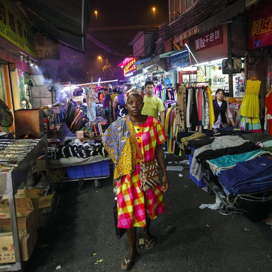 a-woman-walks-at-a-market-in-the-22african-village22-in-guangzhou-e1467294355956